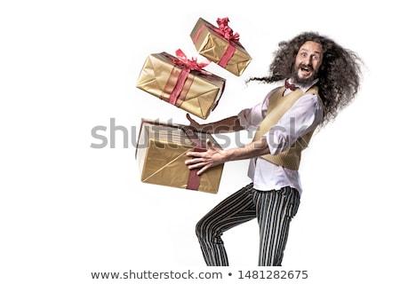 Skinny man running with the bunch of presents Stock photo © konradbak