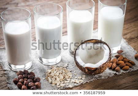Close up of Almonds in wooden bowl and almond milk Stock photo © dash