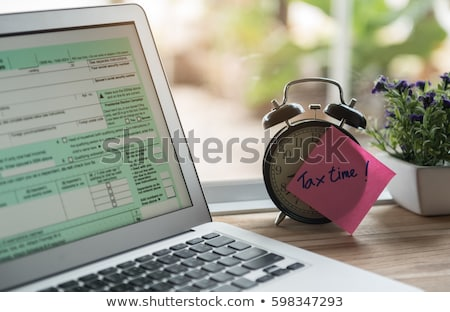 Prepare money to pay tax for the income tax returns Stock photo © johnkwan