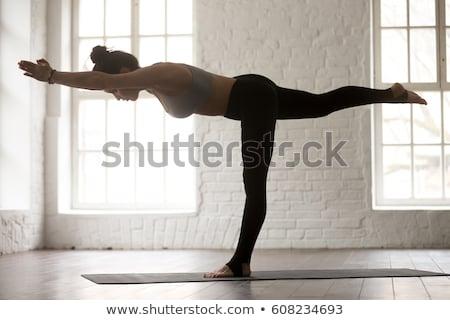 Woman doing Ashtanga Vinyasa Yoga asana Virabhadrasana 3 Warrior Stock photo © dmitry_rukhlenko