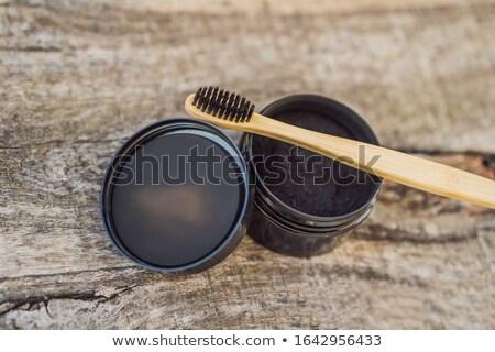 Carvão vegetal pó branqueamento dentes bambu eco Foto stock © galitskaya