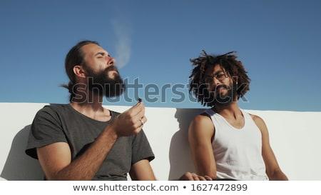 Homem fumador erva daninha jovem homem de negócios trabalhar Foto stock © fahrner