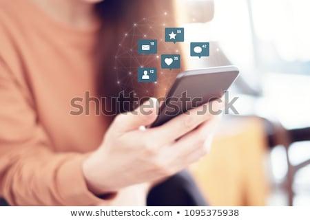Close-up of a touchscreen, social media concept Stock photo © ra2studio