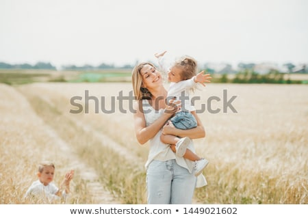 Mother and child  sit on wheaten field Stock photo © Paha_L