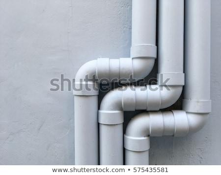 Fuga pipe vecchio muro di pietra costruzione muro Foto d'archivio © trgowanlock