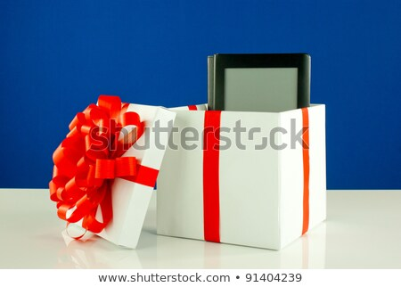Electronic book reader in a box against blue background Stock photo © AndreyKr