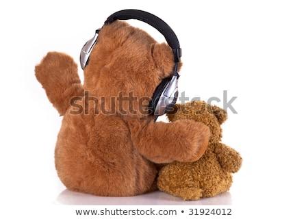 cute · osito · de · peluche · auricular · blanco · fondo · juguete - foto stock © ivelin