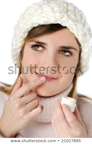 blond woman applying lip stick stock photo © photography33