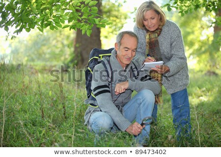 Couple inspecting plants in the forest and making a log Stock photo © photography33