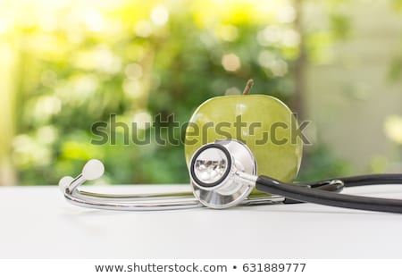 medical stethoscope and green apples stock photo © justinb