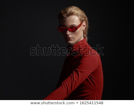 Young man in red rimmed sunglasses Stock photo © photography33