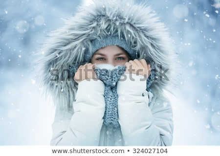 Portrait of woman in snow Stock photo © photography33