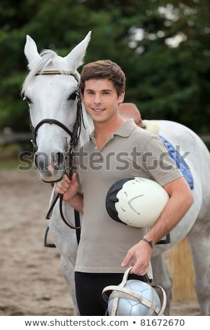Teenage boy stood with horse Stock photo © photography33