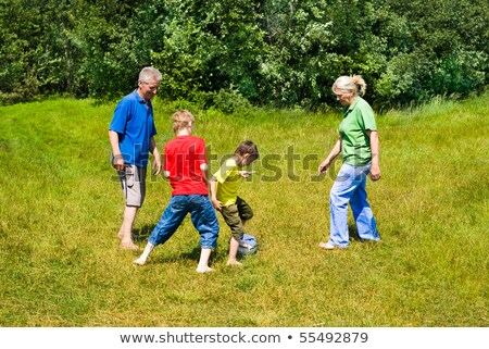 Elderly couple playing with their grandchildren Stock photo © photography33