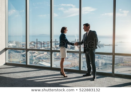 businessman in front of business building stock photo © adamr