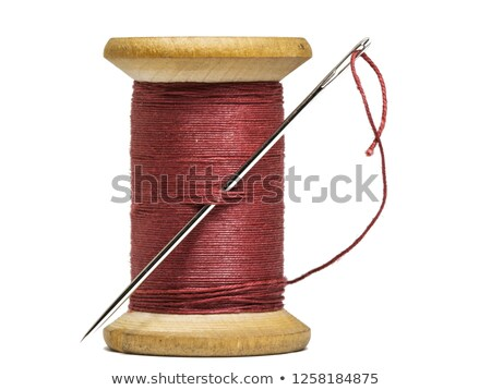 red bobbin with thread and needle Stock photo © compuinfoto