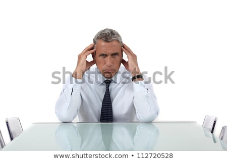 senior business sat alone in meeting room stock photo © photography33