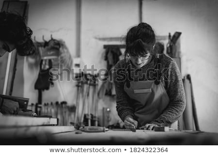 woman sawing wood on work bench stock photo © photography33