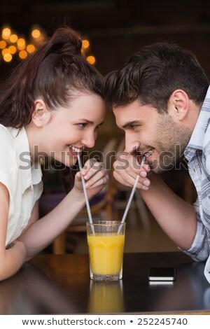 casal · suco · homem · potável · sorridente - foto stock © photography33