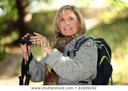 fair-haired elderly woman with binoculars Stock photo © photography33