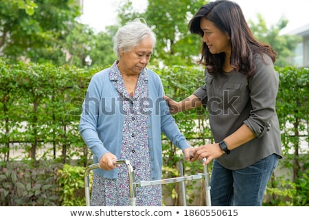 helping elderly woman in the garden stock photo © photography33