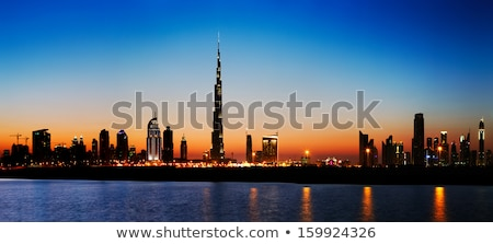 dubai skyline at dusk seen from the gulf coast stock photo © sophiejames