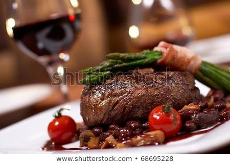 Steak vacsora fotó vesepecsenye rozmaring koktélparadicsom Stock fotó © sumners
