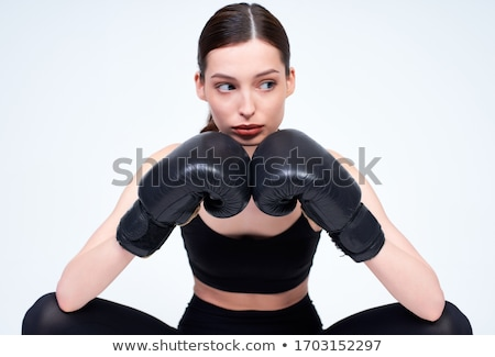 female boxer with serious look on her face stock photo © stockyimages