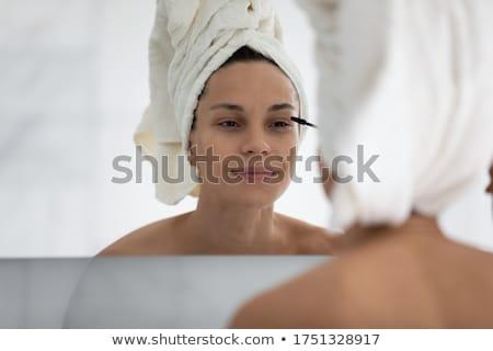 mascara woman putting makeup on eye closeup stock photo © maridav