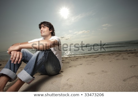casual man with sunset behind looks away stock photo © feedough