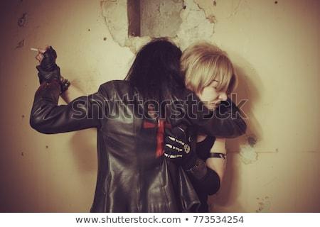 Vampiro mordere vittima male bella bruna Foto d'archivio © Kakigori