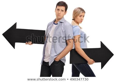 Mannelijke vrouwelijke tegenover borden richting straat Stockfoto © stevanovicigor