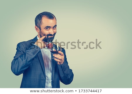 man in green suit with bow tie looks at the camera Stock photo © feedough