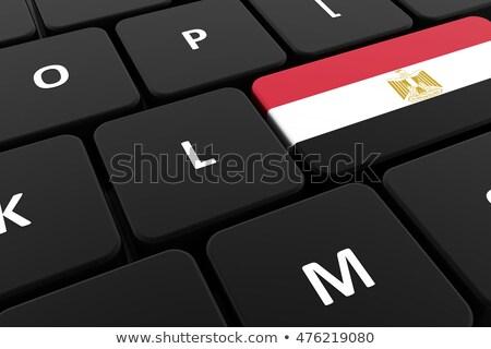 Egypt - Flag on Button of Black Keyboard. Stock photo © tashatuvango