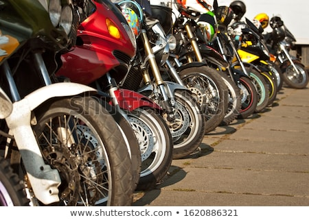 Stock photo: Closeup detail of a motorcycle's front wheel