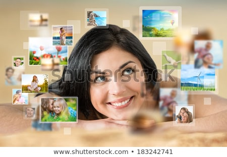 Woman laying on beach with lots of pictures around her Stock photo © HASLOO