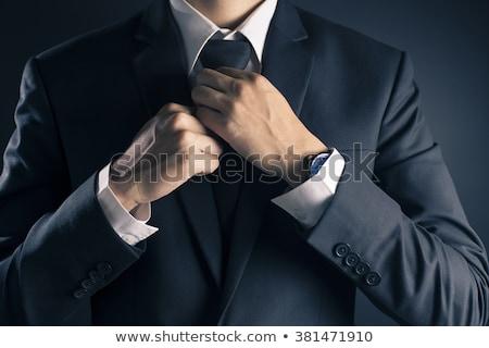 business man binding his tie  Stock photo © meinzahn