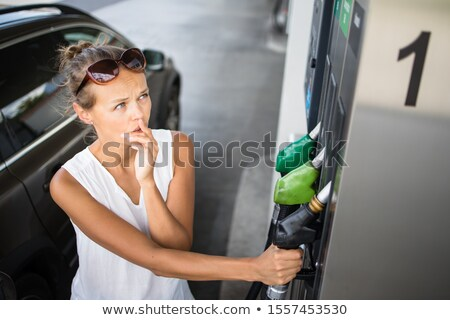 Stock photo: putting gas into the car