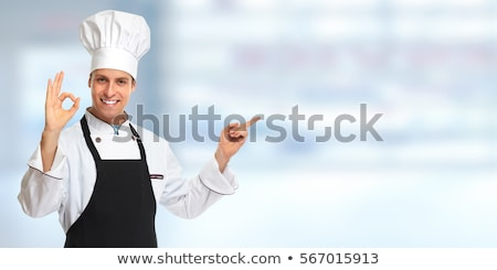 Male chef inviting at restaurant Stock photo © stockyimages