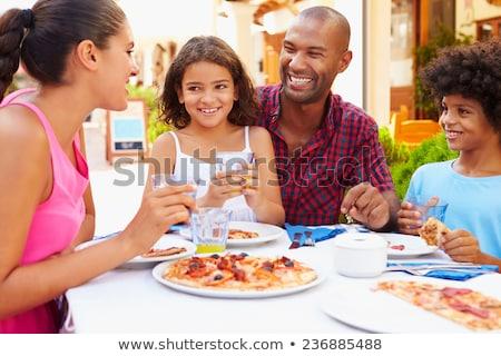 Stockfoto: Familie · vakantie · eten · buitenshuis · vrouw · huis