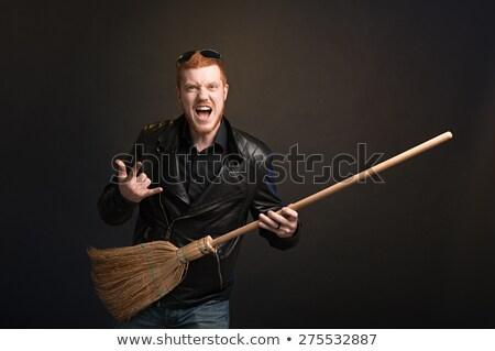 adam · şarkı · söyleme · süpürge · gülen · kulaklık · oynama - stok fotoğraf © feelphotoart