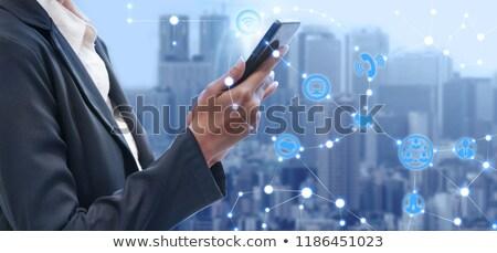 üzletasszony mobil érintőképernyő telefon elegáns üzletasszony Stock fotó © stokkete