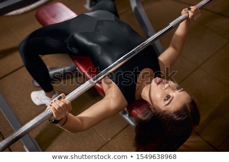Weight Lifter Holding Plates Stock photo © ArenaCreative