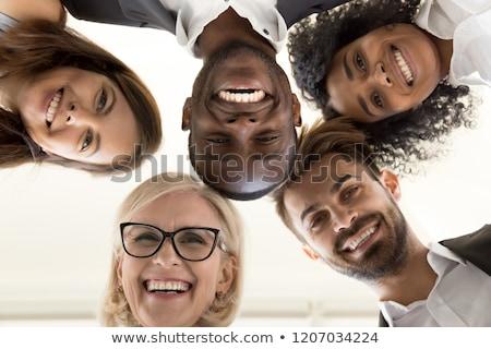 Grupo gente de negocios círculo mirando hacia abajo negocios hombre Foto stock © deandrobot