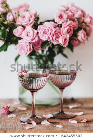 beautiful romantic pink roses in a white vase stock photo © julietphotography