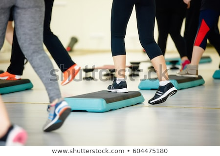 women doing exercise on aerobic step Stock photo © adrenalina