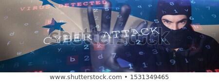 Hacker patrząc kamery czarny komputera Zdjęcia stock © wavebreak_media