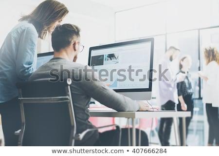 Nő dolgozik asztali számítógép iroda vonzó fiatal nő Stock fotó © deandrobot