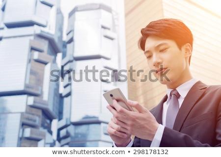japans · man · smartphone · hand · taak · papierwerk - stockfoto © rastudio