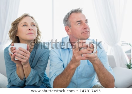 Couple day dreaming and smiling Stock photo © imagedb